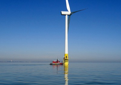 Supply boat docking with wind turbine at Scroby Sands Wind Farm