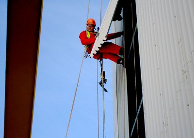 Removing cladding by rope access
