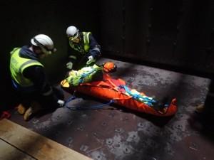 Injured worker being secured into stretcher