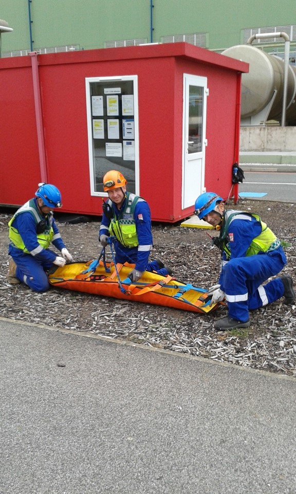 Rope rescue team with rescue stretcher