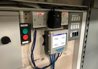 Vacuum monitoring unit on garage forecourt