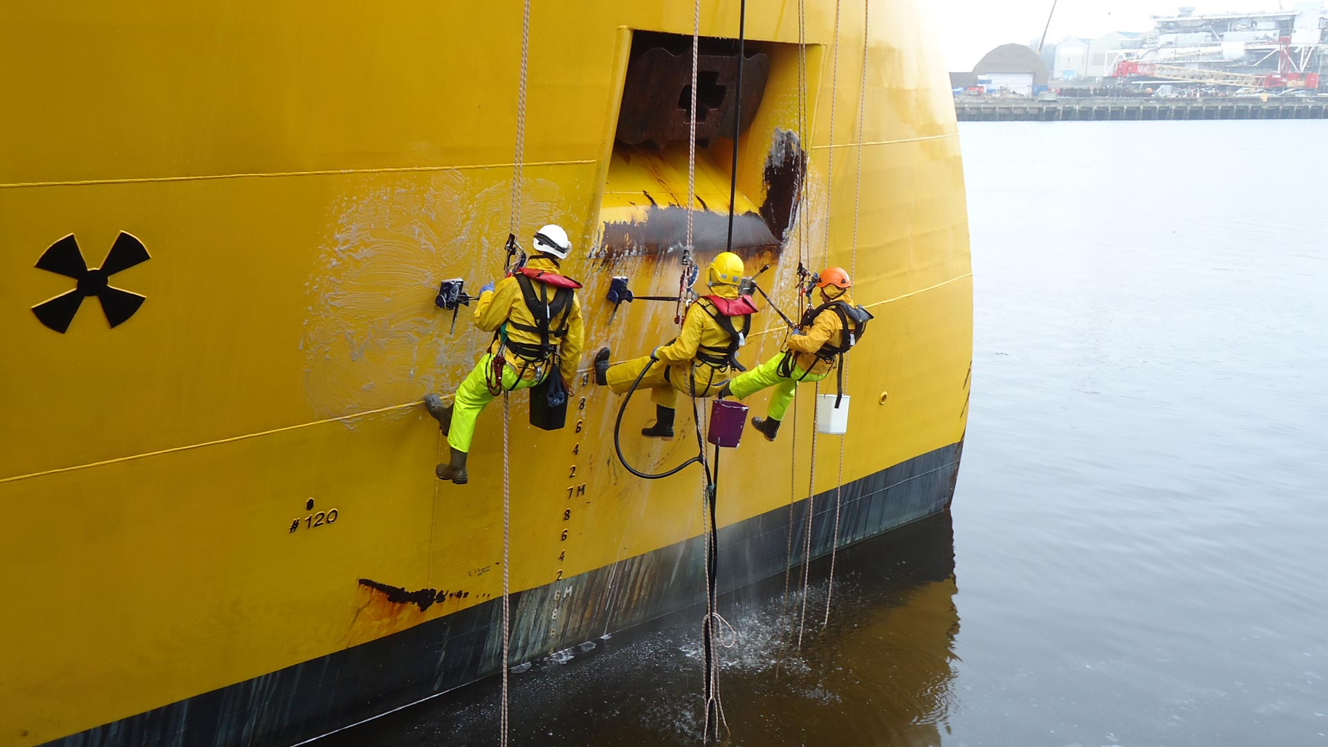 Specialist cleaning by rope access on the hull of a ship. Utilising Abfad's Magnetic Positioning Aid